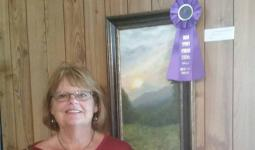Debbie Toney with her painting Good Morning Clinch Mountain