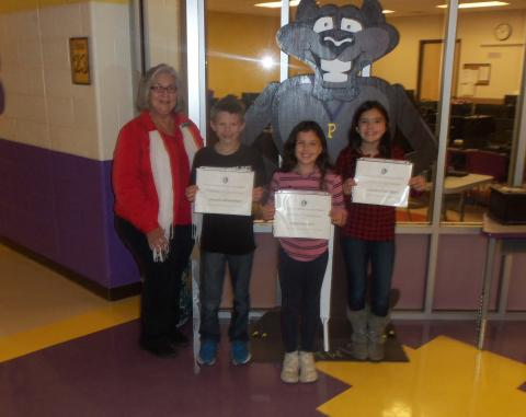 Pictured left to right: Sandra Greene of Union County Soil Conservation District presenting awards to Benjamin Brock, Hadley Berry, and Valentina Moshe.