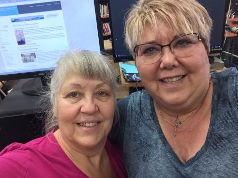 Sharps Chapel Book Station attendant Sherry Medina meets with Maynardville Public Library director Chantay Collins for a workshop on new library technology.