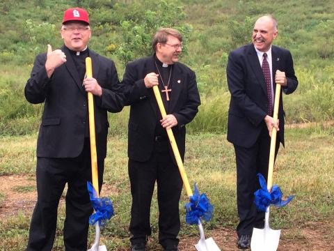 Bishop Richard Stika, Fr. Steve Pawelk and Union County Mayor Mike Williams break ground for the new St. Teresa of Kolkata Catholic Church in Maynardville.