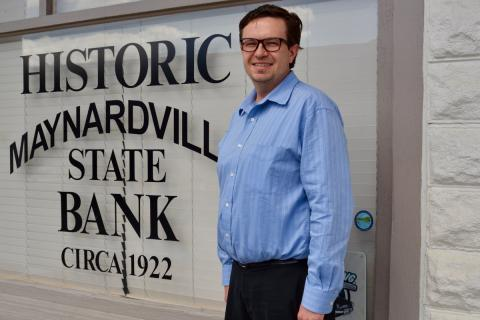 Interim Chamber of Commerce president Thomas Skibinski stands in front of the Chamber's office, currently housed in the historic Maynardville State Bank building.