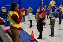 Safe Routes to School education coordinator Diana Benedict coaches Luttrell Elementary School students on hand signals for bike riding.