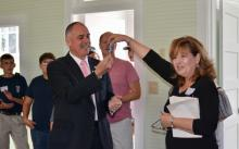 Union County Mayor Mike Williams receives the keys to the newly renovated Oak Grove School from Preservation Union County board member Betty Bullen.
