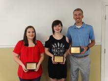 Samantha Sutton, Destini Thomas, Seth Beeler with plaques.