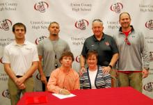 Pictured, seated L-R: Dalton Truan, Cathy Norris, aunt; standing L-R: Cumberlands head wrestling coach Travis Barroquillo, UCHS head wrestling coach James Ramirez, UCHS head football coach Larry Kerr and UCHS assistant football coach Josh Kerr.