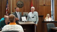Man giving a plaque to a veteran