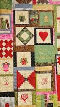 Picture of a memory quilt with hearts, initials, and other icons to remember family members