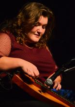 Sarah Morgan performs on stage