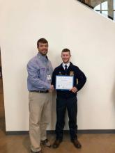 Pictured, John Fugate with Tyler Sweet after receiving his American FFA Degree at National Convention